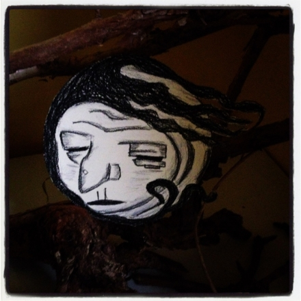 A drawing of Baba Yaga's Face in a nest of twigs.